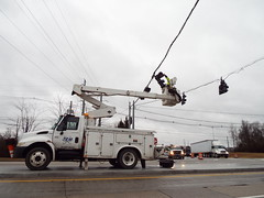 Working Through The Storm (EX22218 - ON/OFF) Tags: lights traffic storm wind louisville kentucky clouds sky wires lines trucks white dark tem flood trees branches rain linemen lift letsguide