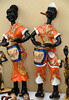 Keeping the Beat (Poocher7) Tags: art crafts woodcarvings cuba carribean figurines drummers congadrummers male female cigar colourful orange percusssion drumming cute couple pair sundaylights handcarved handpainted eltambor