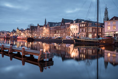 Winter Blues (McQuaide Photography) Tags: haarlem noordholland northholland netherlands nederland holland dutch europe sony a7riii ilce7rm3 alpha mirrorless 1635mm sonyzeiss zeiss variotessar fullframe mcquaidephotography lightroom adobe photoshop tripod manfrotto stad city urban waterside lowlight bluehour dusk twilight schemering outdoor outside building longexposure cityscape water reflection river spaarne rivier calm tranquil peaceful winter cold koud serene wideangle groothoek boat skyline jetty