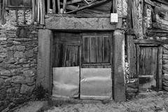 Casas viejas (Eduardo Estéllez) Tags: house old vintage abandoned wooden window architecture home building rural aged exterior uninhabited weathered wall retro traditional country rustic broken deserted landscape facade scary derelict background wood dark empty outside dirty historic countryside village damaged rehabilitated block typical laalberca salamanca spain monochrome estellez eduardoestellez