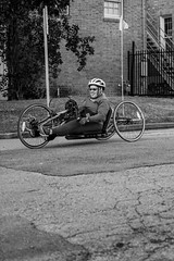 Wheelchair Athlete (burnt dirt) Tags: wheelchair bicycle bike athlete competition helmet uniform marathon halfmarathon 5k course race racer pedal wheel flag road street amputee prosthetic sunglasses glasses downtown town city bw blackandwhite fujifilm camera metro station busstation trainstation hero military xt1 streetphotography urban candid portrait documentary laugh smile winner medal sport vehicle outdoor people person abb5k houston texas houstonmarathon houstonhalfmarathon chevron man woman crank gloves sunny cold forceg