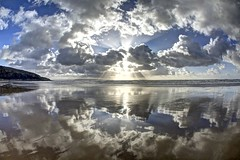 Reflection of the television (pauldunn52) Tags: dunraven beach southerndown glamorgan heritage coast wales wet sand reflections clouds sun burst