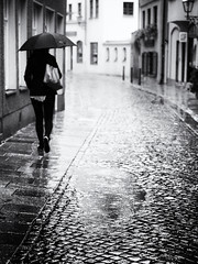 walking in the rain (Sandy...J) Tags: olympus oldtown monochrom fotografie noir mono women cobblestones blackwhite bw black white walking city reflection rain regen regenschirm urban umbrella street streetphotography sw schwarzweis strasenfotografie stadt photography strase kopfsteinpflaster frau atmosphäre alone allein spazieren spiegelung stimmung mood