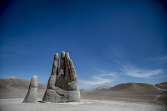 Hand of the Desert (Speedy Russell) Tags: handofthedesert desert sculpture publicart bighand bigfingers massive bleak lifeless statue bluesky rocks sand