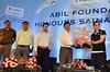 Mr. Avinash Bhosale & Mr.Amit Bhosale of ABIL Group Rewarding Sania Nehwal (ABIL Group) Tags: avinash bhosale amit