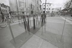 Rimini Multiple Exposure (goodfella2459) Tags: nikon f4 af nikkor 14mm f28d lens bergger pancro 400 35mm blackandwhite film analog rimini multiple exposures sign letters bike rack italy experimental abstract bwfp