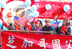 The Americans (kirstiecat) Tags: yearofthedog float parade happychinesenewyear chinesenewyear chinatown chicago street canon color red saturation people americans chicagoans balloons celebration moment
