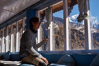 Trekker having rest in Annapurna base camp, Annapurna massif, Nepal