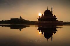 symmetry at dawn.... (MailHamdi) Tags: putrajaya masjidputra mailhamdiimages silhouette dawn nikon d90 tokina1116 wideangle shadow malaysia putrajayalandmark tourism