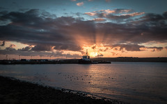 Crepuscular rays (MBDGE 1Million+Views) Tags: orkney sea scotland seascape sun sky ship shore shoreline scapaflow sunset reflection rocks rays canon canon70d cloud clouds contrast northernisles night harbour hill hills pier port panoramic tug boat beach boats bay scenic scotand crepuscular water oceans
