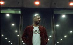 Stanza Divan (fraser_west) Tags: portrait artist london 35mm analog reflection rap hiphop film eos3 lights cinestill 800t barbican wetheconspirators
