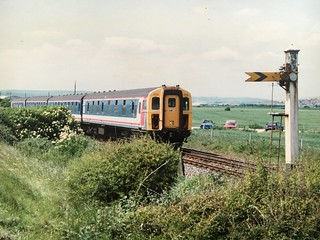 4Cig unit 1713 passes Tide Mills Crossing, and the Up Distant Signal for Newhaven Harbour, with a service to Seaford. Summer 1996.
