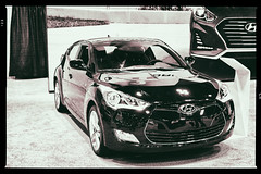 Neither Fast Noir Furious (Trippin' all over the place) Tags: veloster hyundai show stlouis missouri lumix gx7 panasonic pse12 topazlabs nik black white contrast fast loud furious import ricer