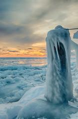 Sunset on ice #3 (tquist24) Tags: hdr lakemichigan michigan nikon nikond5300 stjoseph clouds cold evening frozen geotagged ice icicles lake pier sky sunset water winter saintjoseph unitedstates