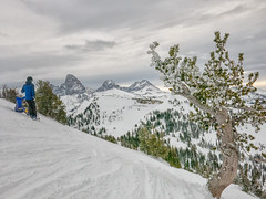 boarder and skier at Grand Targhee (maryannenelson) Tags: wyoming grandtarghee ski snowboard landscape winter clouds sky mountains pines tetons