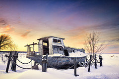 Old fishing boat, The Eagle (susannevonschroeder) Tags: lakesuperior wisconsin boat sky snow sunset winter fishing old