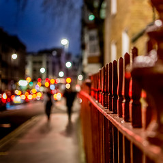 Fairytale On The Streets (DobingDesign) Tags: streetphotography bokeh london mayfair grosvenorestate railings metal tones lighting depthoffield bluehour street people strolling walking together two colour twinkly lights distance colourful nightcolours nightlife streetbeauty streetlife londonstreets