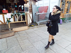 Movement... Nina at the Christmas Market in Belfast December 2017 (sean and nina) Tags: nina christmas market belfast city centre public candid street photography woman female girl lady girlfriend fiancee wife happy amiling marries black duffle coat dress legs dm boots doc martens beauty gorgeous stunning amazing cute charm charming serb north northern ireland irish eu europe european aire glasses brunette long dark hair camer people persons outdoor outside model perfect december 2017 eating drinking smiling walking incredible pose posed posing unposed