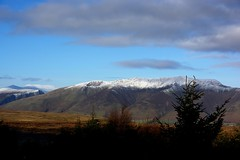 Not on the sunny side (moniquerebanks) Tags: blencathra lakedistrict cumbria uk nationalpark worldheritage merengebied nature scenery view snowtoppedmountain trees silhouette bergen with an