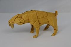 Origami Smilodon (Tankoda) Tags: origami smilodon saber toothed sabertoothed tooth sabertooth tiger prehistoric ice age pleistocene satoshi kamiya travis nolan works paper art deluxe washi origamishop shop shaping white yellow orange gold