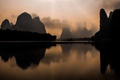 Li River famous mountains (marco_catullo) Tags: river rio mountain montaña china guilin yuan sun reflection clouds silueta