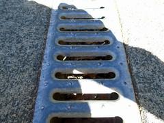 DSC01495 (classroomcamera) Tags: school campus blacktop playground concrete ground drain metal shadow sun sunshine sunlight light angle closeup texture