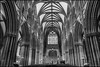 Afernoon practice (G. Postlethwaite esq.) Tags: bw litchfield sonya7mkii staffordshire arches blackandwhite candles cathedral fullframe mirrorless monochrome photoborder pillars rehearsal ribs seating stainedglass window