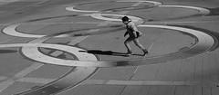 Olympic Spirit (tvdflickr) Tags: georgia atlanta atlantageorgia centennialolympicpark streetphotography street candid fuji fujifilm fujifilmx100f x100f rangefinder photobytomdriggers photobythomasdriggers thomasdriggersphotography male boy child playing running shadow