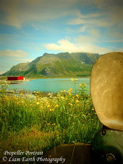 Propeller Portrait (liamearth) Tags: earth shore sky clouds mountain sceneic ripple beautiful sea view outdoor water grass western landscape wild snow norway arctic circle traveling moskenesøya real life camping green rock serene mountainside reine red house rorbuer boat propeller portrait blue