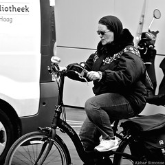 DSCN5030 (Akbar Simonse) Tags: denhaag thehague lahaye agga sgravenhage haag holland netherlands nederland streetphotography straatfotografie people candid woman vrouw fiets bicycle zwartwit bw blancoynegro bn monochrome squareformat vierkant akbarsimonse fietser bril glasses dahon