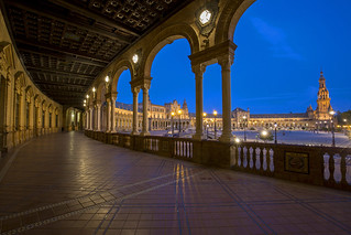The Plaza de España complex with a blue sky at sunset in Seville, Spain