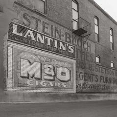 LANTIN'S (Jeff D Welker) Tags: lantins alley arizona ghostsigns globe hasselblad501cm kodaktmax100 zeissdistagon60mmf35tcf