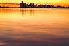 River Of Gold (Wes Iversen) Tags: bellislepark belleisle detroit detroitriver michigan nikkor80400mm architecture buildings cityscapes orange reflections rivers skylines sunsets warm water
