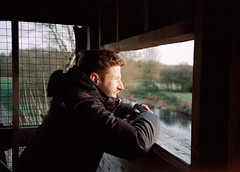 Tim looking out from a hide (dark_dave25) Tags: xa film olympus retro lens zuiko kodak analogue analog