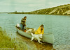 Chunk Keith and Henning Von Krogh bring  Fred Riddle's dog team to a timber site, Damant Lake, 1975 (frankmetcalf) Tags: fmnwt canada northwestterritories damantlake fredriddle dog team canoe dogteam paddle outboard