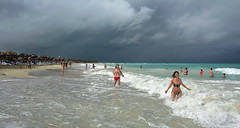A Little Fun Before the Storm (Poocher7) Tags: people portrait swimming wading shoreline shore sand beach waves foam water ocean fun splashing shelter loungechairs stormcoming raincoming cloudy rainclouds storm darkclouds varadero cuba carribean enjoyingthewaves