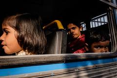 Untitled (koushiksinharoy1) Tags: portrait faces expression kolkata light afternoon bus passenger kids girl lady boy shade streetphotography streetphotographers emotion lightandshade streetphotographycolor gaze eyes