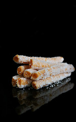 2018 Sydney: A Stack of (Apricot) Logs (dominotic) Tags: 2018 food snack confectionery apricotcoconutlogs smileonsaturday heaped astackofapricotlogs stacked reflection blackbackground orange sydney australia