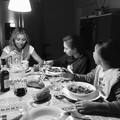 A family intimacy moment in Venice (Hive Bee) Tags: venice eat table dinner wife 35mm bw blackandwhite intimacy family
