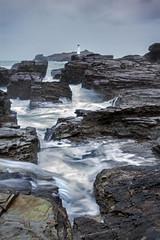 Ominous (Andrew Hocking Photography) Tags: godrevy lighthouse cornwall england seascape landscape coast rugged winter stormyrain rocks hdr seaside ocean landmark longexposure slowshutter