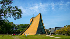 Pilgrimage (Jimweaver) Tags: pilgrimage christ cross church taichung taiwan meadow sky blue roof triangle pyramid grass cloudy tree path design building 建築 金字塔 貝聿銘 東海 草地 西屯 教堂 設計 綠 藍 三角 architecture 天空 台中 龍井 asia 亞洲 canon eos 80d