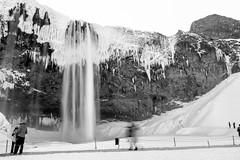 Seljalandsfoss Long Exposure (timnutt) Tags: blur winter water mono snow longexposure bw waterfall monochrome iceland fuji movement people blackandwhite x100t seljalandsfoss