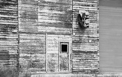 Abandoned Building (maytag97) Tags: maytag97 nikon d750 blackandwhite bw abandoned building pattern grid geometry old rural faded paint wood white door texture black abstract wall structure wooden material surface board rough timber plank design nature entrance vintage retro architecture
