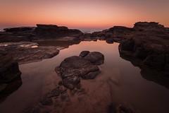 6/100x: Turtle rock at sunset. (jenniferdudley) Tags: holiday sun fullframe nikkor nikond4s nikon australia queensland mooloolaba sunshinecoast water rock rockpool pool splash seaside sea beach rocks sunsets sunset