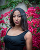 Deja in the garden (Tex Texin) Tags: dejavigil model outdoor portrait girl female flowers red brunette deja face headshot sleeveless shoulder garden redlips