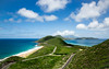 Timothy Hill View - St. Kitts & Nevis (Irrational Photography) Tags: st kitts nevis hill timothy view sky ocean sea caribbean green grass road winding curve down atlantic mountain cloud pavement blue white color canon slr dslr t2i 550d 5d mark iii digital photo picture lens basse terre basseterre kitian village beach sand waves frigate bay ship wreck shipwreck bar south friar friars contrast shadow wide angle sun bright small aperture tropical paradise day time irrational photography