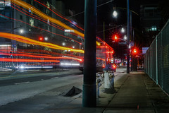 the 55 (pbo31) Tags: sanfrancisco california nikon d810 color night dark black urban january winter 2018 boury pbo31 city missionbay 3rd street lightstream motion traffic roadway muni bus red infinity ucsf medicalcenter motionblur 55 stop curb