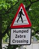 Humped Zebra Crossing, Manchester, UK (Robby Virus) Tags: manchester england uk unitedkingdom britain greatbritain humped zebra crossing sign signage crosswalk pedestrians street