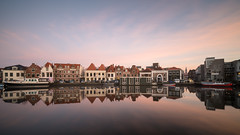 Water City (McQuaide Photography) Tags: haarlem noordholland northholland netherlands nederland holland dutch europe sony a7rii ilce7rm2 alpha mirrorless 1635mm sonyzeiss zeiss variotessar fullframe mcquaidephotography lightroom adobe photoshop tripod manfrotto stad city urban waterside lowlight sunset zonsondergang outdoor outside building longexposure cityscape sky water reflection river spaarne rivier ndfilter neutraldensity bwfilters atmosphere atmospheric calm tranquil peaceful 169 widescreen winter cold koud serene wideangle groothoek boat houseboat woonboot skyline