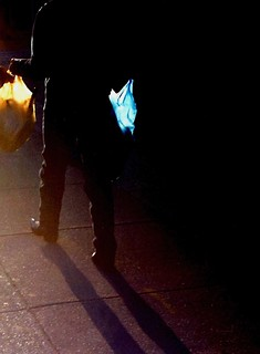 Man with bags walking into the sun, Washington, DC   December 1997. Plastic bags have been subject to a 5c tax in Washington since 2009.